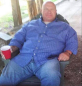 Ray-sitting-in-chair-image